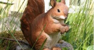 Smukke træfigurer til haven eller hylden er den perfekte gave til en dyreelsker